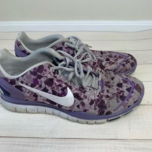 Purple speckled Nike free running shoes
